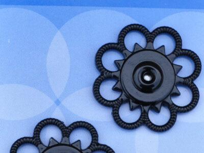 Tryklåse og trykknapper sort blomst